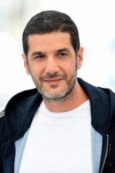 """NABIL AYOUCH IS MADE UP BY DIOR FOR THE FACE : DIORSKIN FOREVER SKIN CORRECT - NEUTRAL 3.5N DIOR BACKSTAGE POWDER-NO-POWDER - NEUTRAL 4N CANNES, FRANCE - JULY 16: Director Nabil Ayouch attends the """"Haut Et Fort (Casablanca Beats)"""" photocall during the 74th annual Cannes Film Festival on July 16, 2021 in Cannes, France. (Photo by Daniele Venturelli/WireImage)"""
