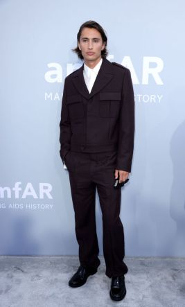 JAMES TURLINGTON IS DRESSED BY DIOR HE WORE A PURPLE MOHAIR WOOL PEAK LAPEL OFFICER SUIT, A WHITE SILK SHIRT AND BLACK LEATHER DERBIES WITH SADDLE DETAI CAP D'ANTIBES, FRANCE - JULY 16: James Turlington attends the amfAR Cannes Gala 2021 at Villa Eilenroc on July 16, 2021 in Cap d'Antibes, France. (Photo by Andreas Rentz/amfAR/Getty Images for amfAR)