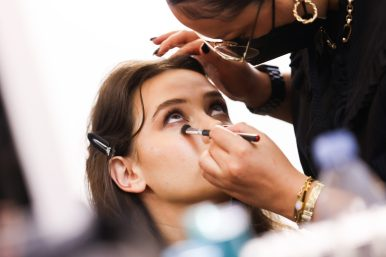 """PARIS, FRANCE - OCTOBER 03: Katherine Langford prepares backstage prior to 'Le Defile L'Oreal Paris 2021"""" as part of Paris Fashion Week on October 03, 2021 in Paris, France. (Photo by Vittorio Zunino Celotto/Getty Images For L'Oreal)"""