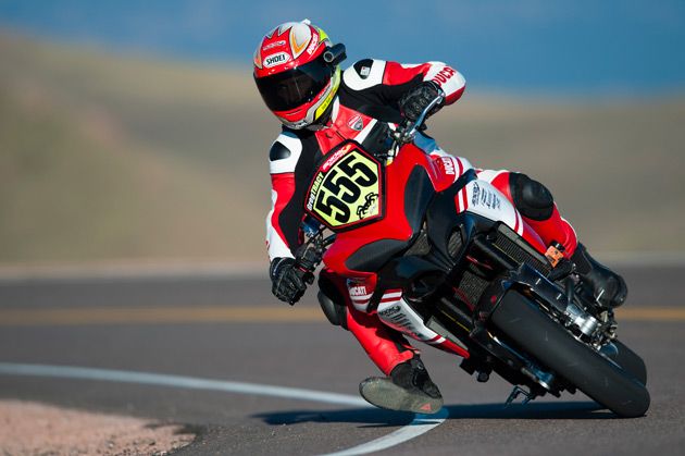 """Ducatisti around the world are celebrating the victory of Carlin Dunne and the Spider Grips Ducati Team – we are all very proud,"" said Dominique Cheraki, General Manager of Ducati North America. ""Three years ago we chose the Multistrada 1200 S to compete at Pikes Peak to showcase its on-and-off road capabilities, class-leading ergonomics, handling, and performance. When we were alerted that the entire course would be paved in 2012, there was no doubt that the Multistrada 1200 S was still the right choice and breaking the record today proves this."" Photo credit: Jamey Price"