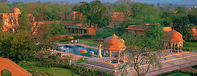 The Oberoi Rajvilas is an idyllic retreat that evokes princely Rajasthan with luxury villas and royal tents in a fort-like setting. It is built in a traditional Rajasthani fort style. Spread over 32 acres of lush gardens, flowering trees and cascading fountains, the hotel offers a perfect base from which to explore one of India's most exotic and vibrant city - Jaipur.