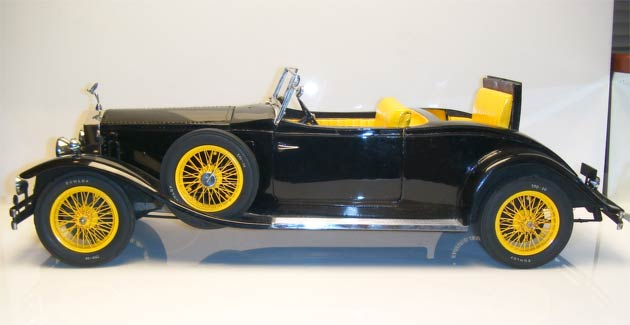 This model is approximately 65cm long and is a completely scratch-built model, made in 1973. It features all metal construction, except for a few details, hence it's weight of 13lbs. The model has engine and chassis detail, as well as working features including working steering, opening bonnet, three opening doors one of which is to the opening rumble seat. It also has a removable convertible top.