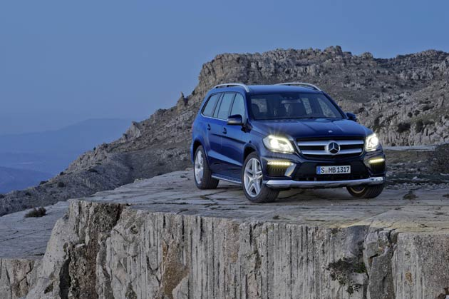 """The all-new Mercedes Banz GL 63 AMG, has a better specification than the GL 350 BlueTEC AMG Sport, with key exterior elements including flared wheel arches with 21"""" AMG five-twin-spoke light-alloy wheels in Titanium Grey; AMG high-performance braking system; Active Curve System with AirMATIC, which compensates the roll angle of the vehicle body when driving round bends; and an AMG sports exhaust system with two chromed twin tailpipes."""