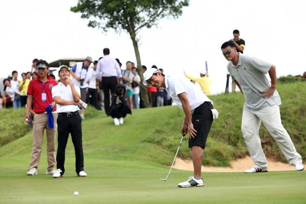 Former basketball star Yao Ming and guests of Audemars Piguet on the green.