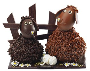 Frisoton and Frisette duo (700g costing £116): hand-made limited-edition piece. Pieces and decor composed of dark chocolate, milk chocolate and ivory chocolate. Pieces are filled with praline eggs – 3 crepe dentelle praline eggs, 3 almond milk pralines, 3 dark chocolate and hazelnut pralines, 3 dark and crispy chocolate pralines, 2 dark chocolate fish, and 2 milk chocolate fish.