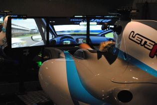 As you prepare yourself in the seat of the Lets Race simulator you are aware of your grid position