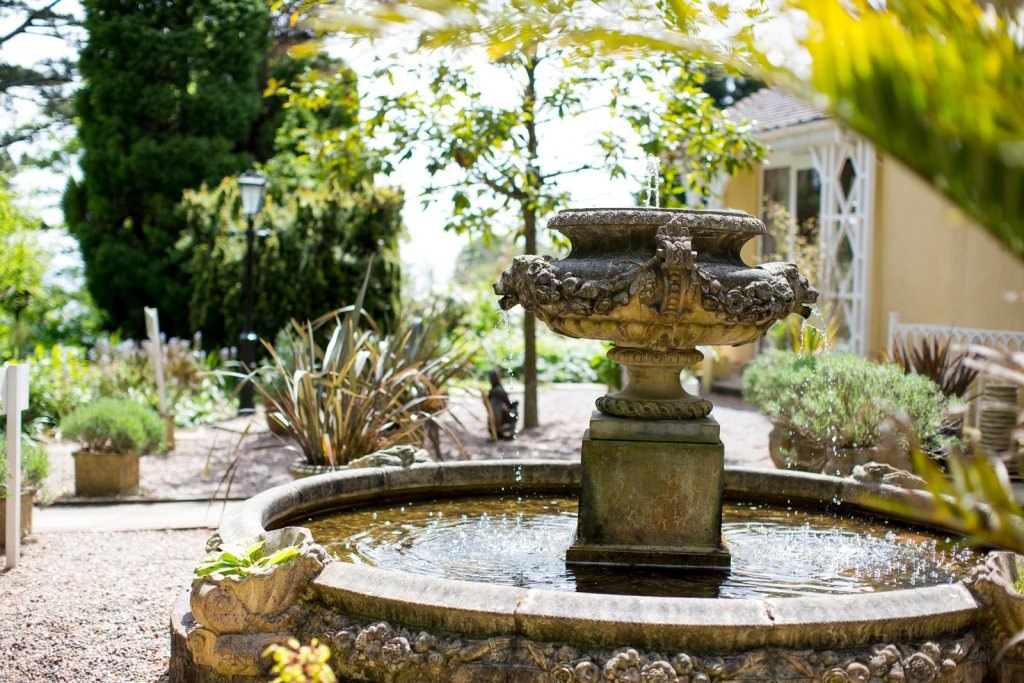A stone fountain with flowing water in the garden