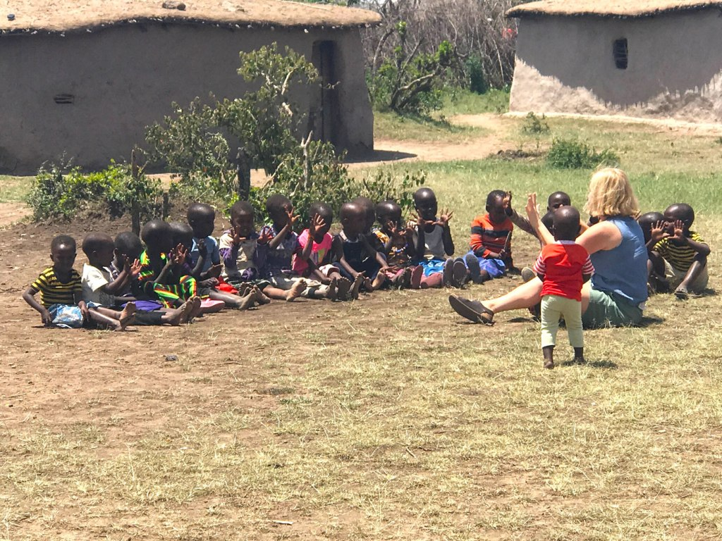 Gina with some children at a local Maasai village