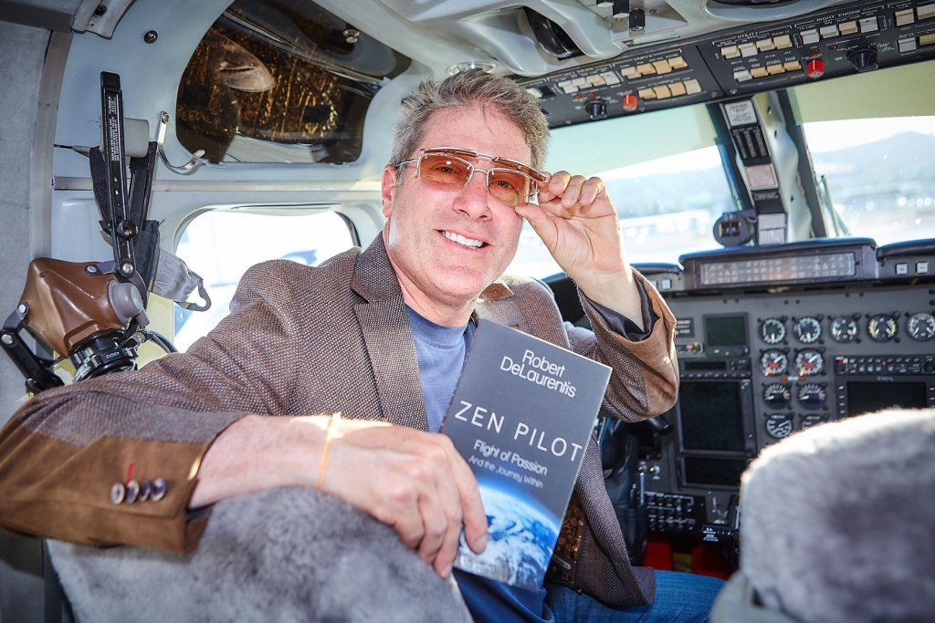 """Peace Pilot"" Robert DeLaurentis with his book Zen Pilot"