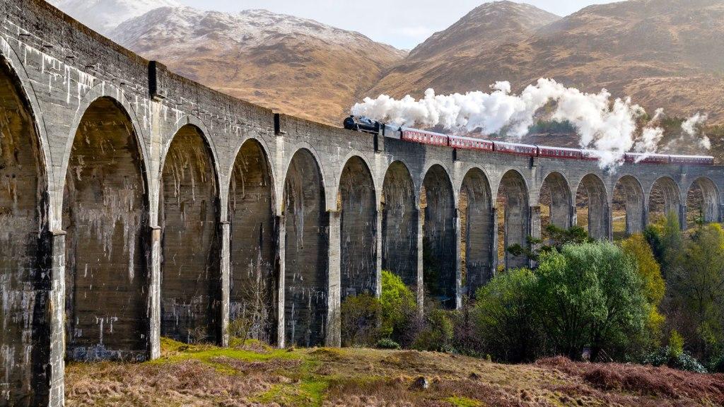 Steam Train going over bridge in Scotland