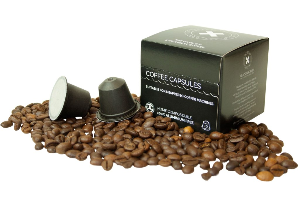 Box of Black Insomnia Compostable Coffee Pods with beans