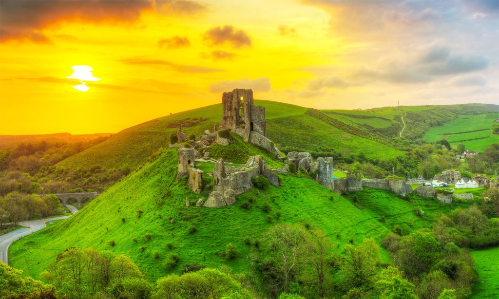 Corfe Castle in Dorset at sunset