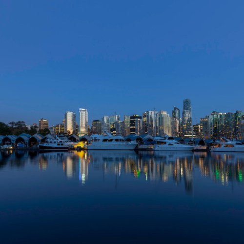 Tranquil night scene of Royal Yacht Club Marina and downtown high-rises reflecting in Vancouver's Coal harbour. BC, Canada.
