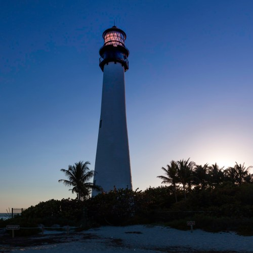 Lighthouse surrounded by palms at Bill Baggs State Park in Key Biscayne, Florida. USA