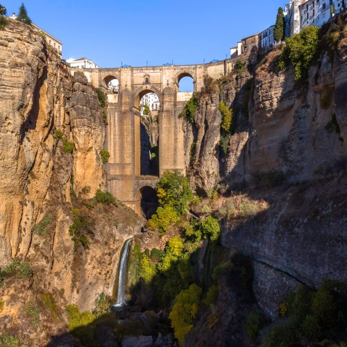 Dramatic New bridge built in 18th century over the El Tajo canyon in Ronda, one of the famous White Villages in Andalusia, Spain.