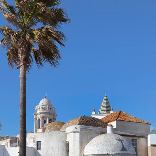 White washed church and buildings of ancient city of Cadiz on the Atlantic coast of Spain.