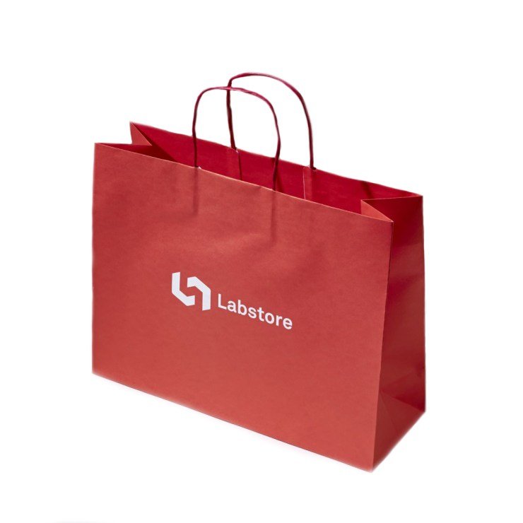 Premium quality printed kraft paper bag with twisted handle.