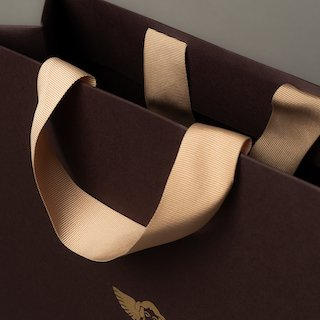 Grosgrain ribbon handle inserted into top fold area