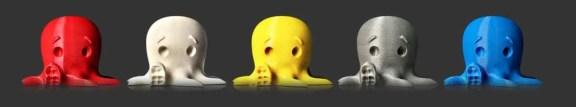 Modelos impressos em 3D em cores diferentes (vermelha, creme, amarela, grafite e azul).