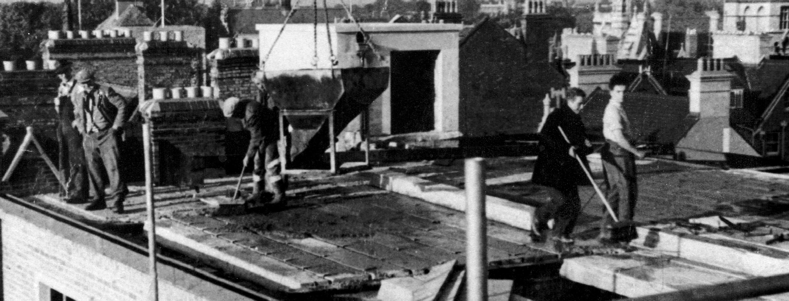Builders on the roof of the original Clarendon Centre in Oxford