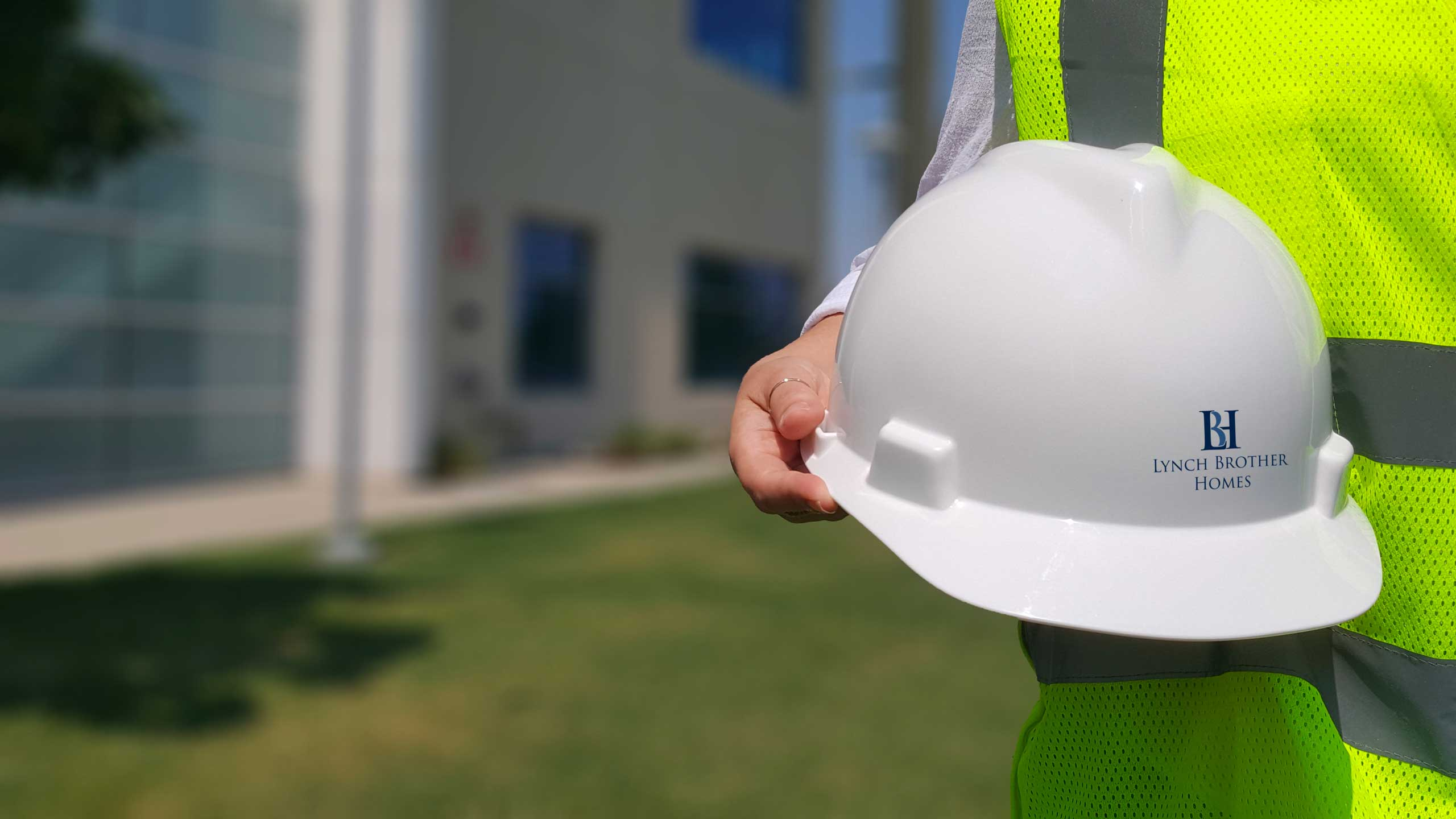 hardhat with Lynch Brother logo being held