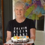 Lynda with tray of Birthday Cupcakes
