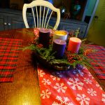 Advent Candles set into fresh pine and bittersweet berries on my dining room table.