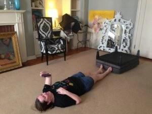 Stacy taking break? NEVER, she's helping to flatten out the carpet that got wrinkled in the move.