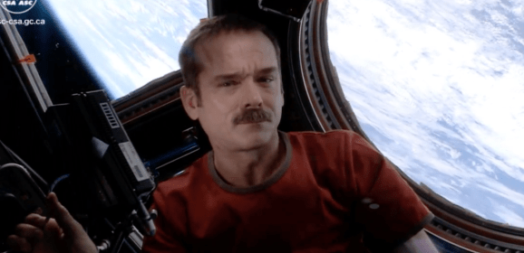Commander Hadfield does triple cool: First music video from space!