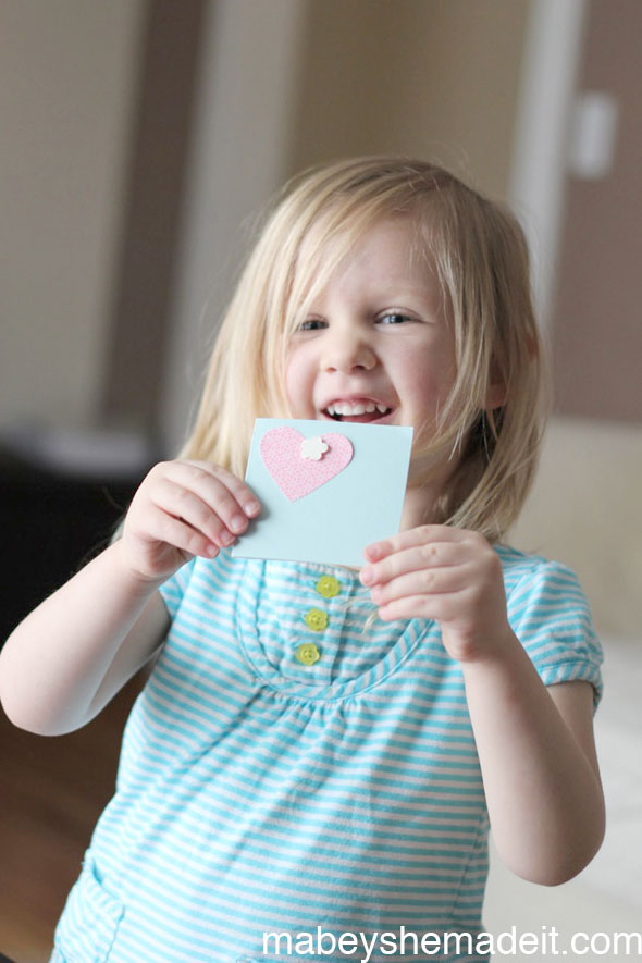 Make these simple Valentines Cards with your little one to pass out to friends. They love helping with the process, and they're super cute.
