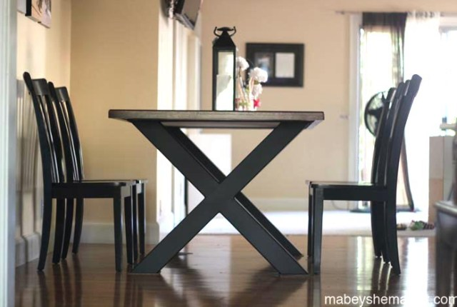 This gorgeous dining table was made from reclaimed mahogany and a custom steel base. The thrifted chairs were refinished and together the set is stunning. See more here.