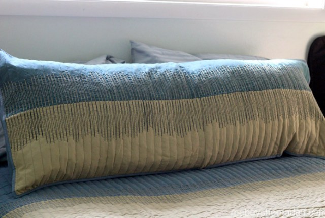 Super simple way to turn the regular shams from your bedding into a body pillow cover to match your comforter.