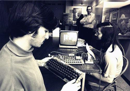 Steve Jobs and Steve Wozniak using Apple 1 computer system, ca. 1976