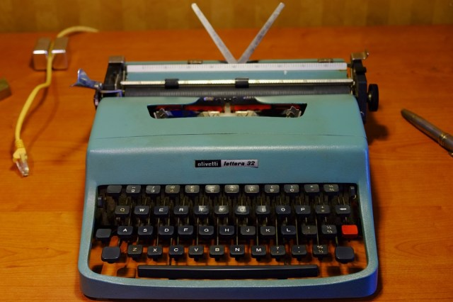 Above: My late 1960s Olivetti Lettera 32 (Ethernet cable not required). Below: Similar vintage Olympia Traveller De Luxe. These are fine examples of the mechanical portable typewriter in its most refined form