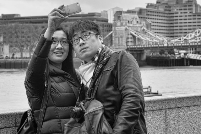 Never miss a selvesiein front of Tower Bridge: In this case the far more competent Sony RX1 was left neckdangling while the versatile iPhone was pressed into service. Judging from the phone cover, these two trophy huntershavejust arrived from the Eiffel Tower and wantto add to their collection.Photo Mike Evans.