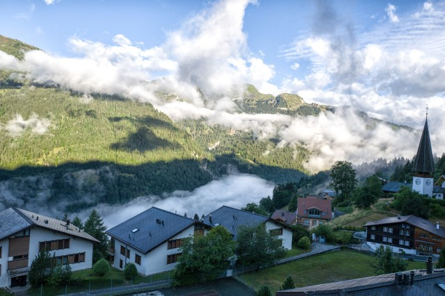 Morning in the village of Wengen with low-lying clouds settling into the Lauterbrunnen valley