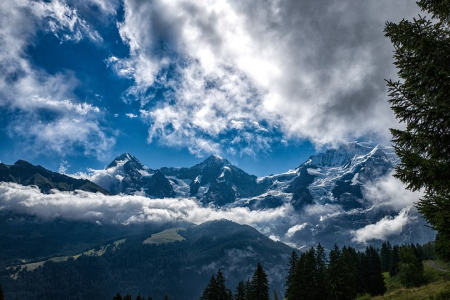 The three strong men of the Bernese Oberland—Eiger, Mönch and Jungfrau (partly hidden by clouds). See the Jungfraujoch buildings in the saddle between Mönch and Jungfrau. This is Europe