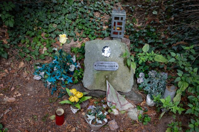 """Above: Visitors manage to find the spot regularly, judging by the flowers. Below: The plaque says, """"In eternal memory of Jimmy Clark, born 4.3.1936 Kilmany, Scotland. Died here 7.4.1968"""""""