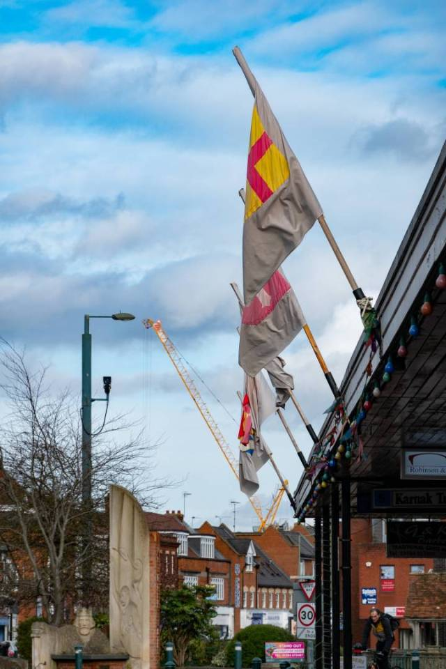The flags of the nobles of Runnymede keep watch over the 21st Centery High Street