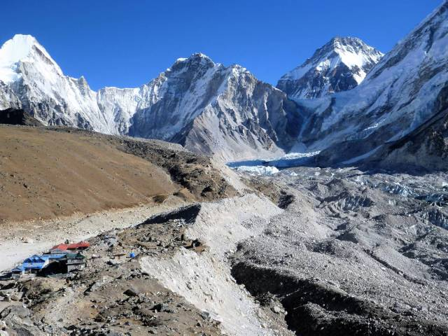 A big mountain and a small sensor camera. Approaching the lodges at Gorak Shep (left front), the site of the Swiss 1952 base camp. The 1953 British and present day base camps are at the base of the glacier (centre of image). The face of Everest as seen from base camp in Nepal has an area a million trillion times greater than the size of the little 1/2.3 sensor in the Sony DSC W350. But the tiny Sony did a good job capturing this image.