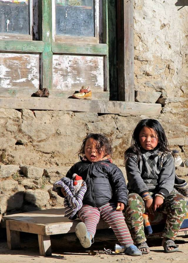 The children do wonder why Western trekkers are there, trudging higher and higher.