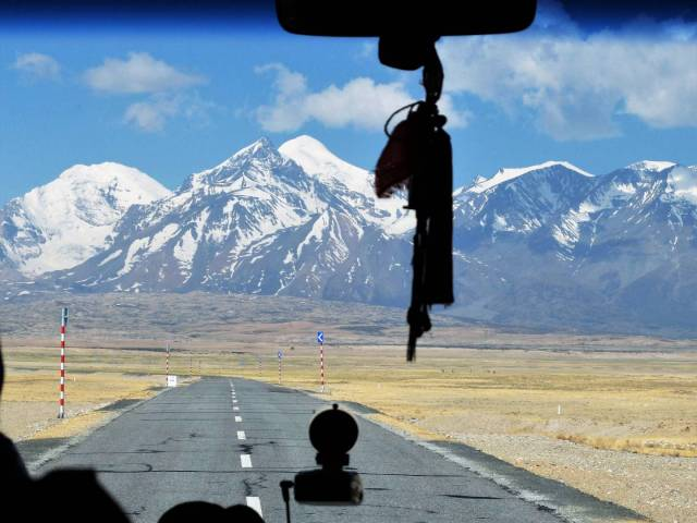 The new China Tibet road into the Everest region as seen from the minibus. Only a few years old, it provides a true road trip across the Tibetan plateau.