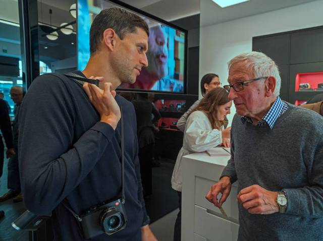 Chris Angeloglou chatting with Leica Ambassadord Robin Sinha. Louise in the background taking oders for David Suchet's book, Behind the Lens.