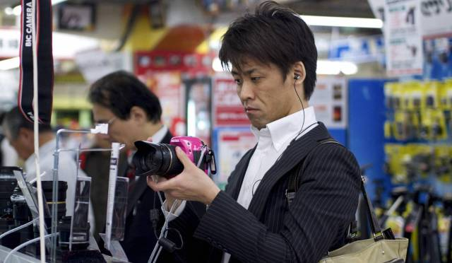 Trying cameras in the big BIC store, big city Tokyo