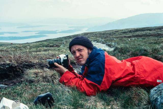 A younger self, always the photographer, taken by my father in 1999
