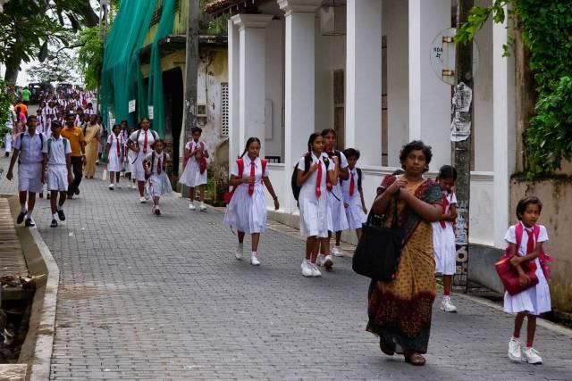 Kids in their distinctive Kannangara school uniforms