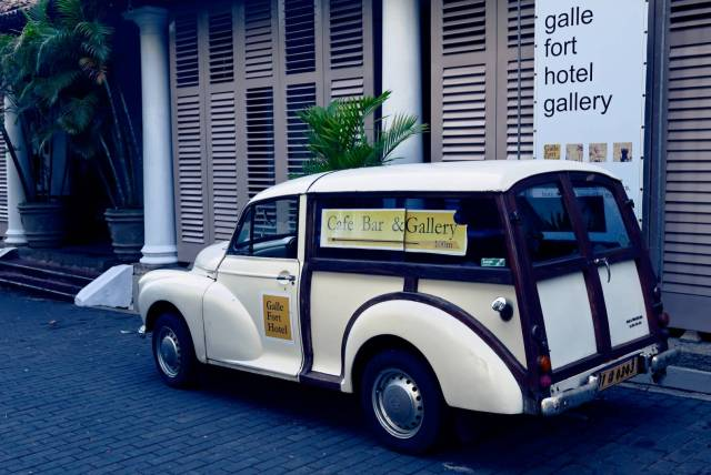 A Morris Minor 1000 parked by the entrance