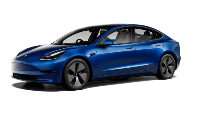 """The Macfilos Model 3: Blue with white interior. The dechrome, noticed partiuclarly in the window surrounds and on the door handles, is now standard for 2021 models. The white """"vegan leather"""" interior is both woke and rather luxurious in appearance. Those Aero wheels look odd, but they have plastic covers to improve the aerodynamics and improve range; they can be taken off to reveal normal-looking alloys."""