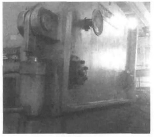 Fig. 5 Presser foot mechanism of shearing machine