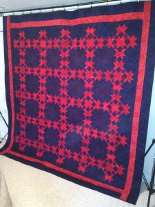Red Stars in a Midnight Sky Quilt